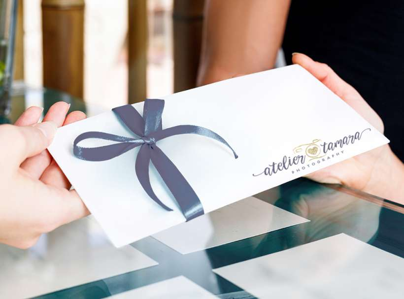 Receptionist woman gives gift certificate to young couple for visit spa salon.